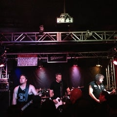 Photo taken at The Slidebar Rock-N-Roll Kitchen by Wes on 12/29/2012