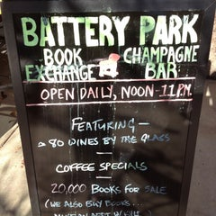 Photo taken at Battery Park Book Exchange And Champagne Bar by Peter on 11/24/2012