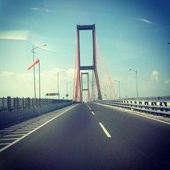 Photo taken at Jembatan Suramadu (Suramadu Bridge) by Muhamad F. on 9/15/2012