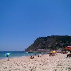 Photo taken at Praia de Itacoatiara by Rafael Ribeiro on 1/1/2013