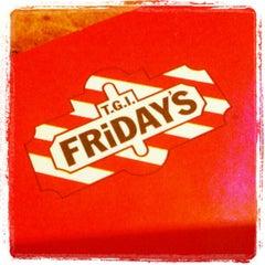 Photo taken at T.G.I. Friday's by NekoMimi K. on 12/24/2012