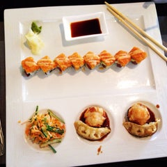 Photo taken at Wild East Pan-Asian Bistro by Jessica on 5/23/2014