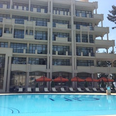 Photo taken at open air swimming pool @ Georgia Palace Hotel by Kristi on 6/7/2013