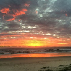 Photo taken at Nobby Beach by Nick H. on 3/24/2015