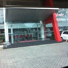 Photo taken at Auto 2000 by Putri I. on 12/20/2013