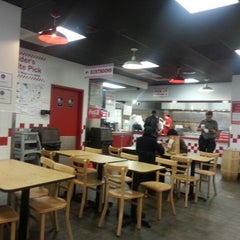Photo taken at Five Guys by Esther C. on 10/14/2012