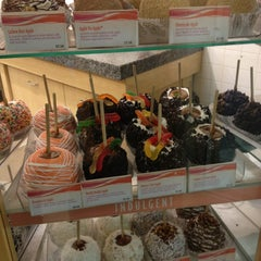Photo taken at Rocky Mountain Chocolate Factory by Emily C. on 5/20/2013