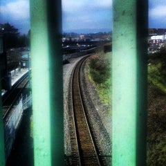 Photo taken at TriMet NE 60th Ave MAX Station by Lale P. on 3/11/2014