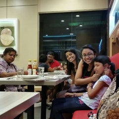 Photo taken at Pizza Hut by Pooma Devi P. on 12/20/2014