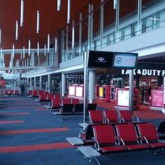 Photo taken at Aeropuerto Internacional de Ezeiza - Ministro Pistarini (EZE) by Carlos S. on 3/20/2013