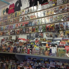 Photo taken at Ash Avenue Comics and Books by Rosa N. on 9/27/2012