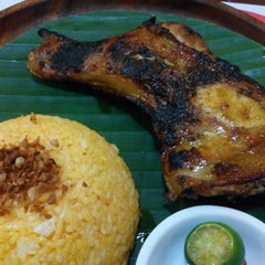 Photo taken at Bacolod Chicken Inasal by Beige T. on 7/24/2014