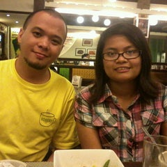 Photo taken at Powerbooks by Cheska L. on 3/19/2013