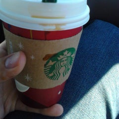 Photo taken at Starbucks by Paulo D. on 12/21/2012