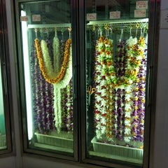 Photo taken at Cindy's Lei & Flower Shoppe by susieschmoozee on 12/16/2013