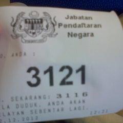 Photo taken at Jabatan Pendaftaran Negara Negeri Perak by Amjad H. on 12/12/2012