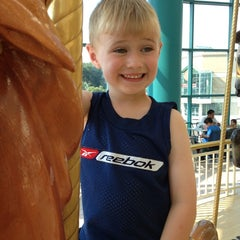 Photo taken at The Carousel @ Carousel Center by TJ M. on 7/19/2013