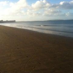 Photo taken at Long Bay Beach by Seonaid L. on 4/27/2013