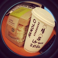 Photo taken at Starbucks by Arnold M. on 10/9/2014