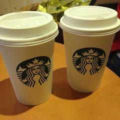 Photo taken at Starbucks by Julia R. on 6/11/2013