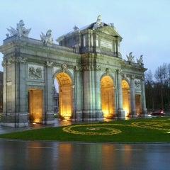 Photo taken at Puerta de Alcalá by Olga K. on 3/29/2013