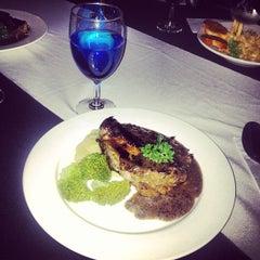 Photo taken at La Taverna Restaurant by Karthik T. on 6/5/2013