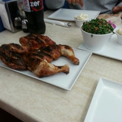 Photo taken at Hot Rocks Charcoal Chicken by Charles A. on 5/2/2013
