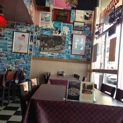 Photo taken at New Yorker Pizza & Restaurant by Wayne on 3/22/2013