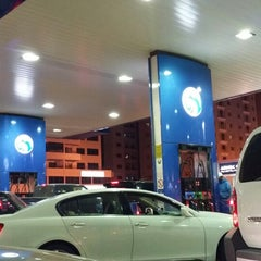 Photo taken at ADNOC by '''Murad G. on 2/6/2014