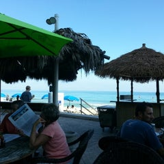 Photo taken at Bamboo Beach Tiki Bar & Cafe by Alexey S. on 11/25/2012