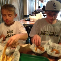Photo taken at Wingstop by Andy N. on 3/27/2013