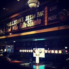 Photo taken at Mulligan's Irish Bar by winingwingz on 4/14/2013
