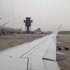 Photo taken at Gate A5 by Ulyana D. on 11/23/2014