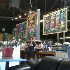 Photo taken at Millcreek Coffee Roasters by Travis R. on 6/11/2013
