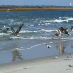 Photo taken at Sunset Beach by Catherine B. on 11/21/2012