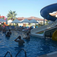 Photo taken at Sun City Apartments & Hotel by Seren Y. on 7/18/2015