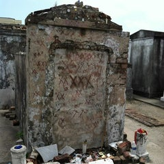 Photo taken at Tomb Of Marie Laveau by Lorrae L. on 6/13/2013