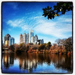 Photo taken at Piedmont Park by Andy R. on 3/10/2013