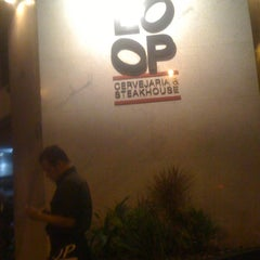 Photo taken at Loop Cervejaria & Steakhouse by Marcus M. on 6/10/2012