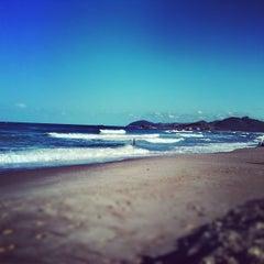 Photo taken at Praia da Ferrugem by Jaisson R. on 3/25/2012