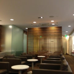 Photo taken at Oneworld Business Lounge by Juan J B. on 3/24/2013