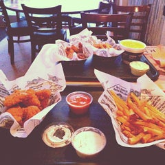 Photo taken at Wingstop by Reynaldo A. on 4/15/2013