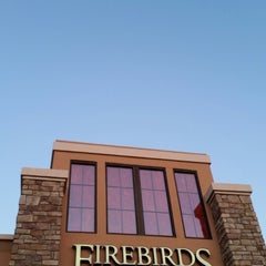 Photo taken at Firebirds Wood Fired Grill by Stelios S. on 3/10/2015