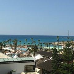Photo taken at Adams Beach Hotel by Анастасия А. on 4/5/2013