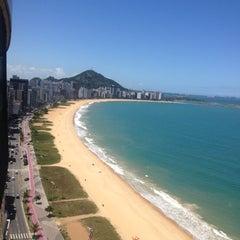 Photo taken at Praia da Costa by Rafael H. on 2/19/2013