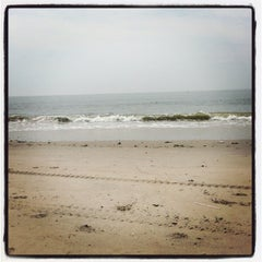 Photo taken at Sea Gate Beach by Jaugen I. on 6/18/2013