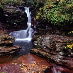 Photo taken at Ricketts Glen State Park by Aaron C. on 10/15/2012