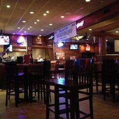 Photo taken at Smokey Bones Bar & Fire Grill by Christie M. on 10/27/2012