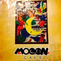 Photo taken at Mooon Café by Jeremy D. on 5/11/2014