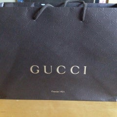 Photo taken at Gucci by Christina S. on 7/18/2015